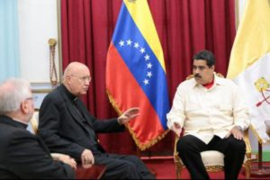 "Archbishop Claudio Maria Celli, seen here speaking with Venezuelan President Nicolas Maduro, said leaders have to show that these are not ""biblical times"" -------------------------------------------------------------------------------------------"