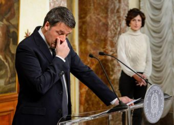 epa05660299 The Italian Prime Minister, Matteo Renzi, speaks at the Palazzo Chigi in Rome, Italy, 04 December 2016 after the referendum on constitutional reform, with his wife Angese Landini in the background. Matteo Renzi has announced his resignation after exit polls on 04 December 2016 suggest a 'No' vote victory in a crucial referendum to which Renzi had tied his political future. The referendum is considered by the government to end gridlock and make passing legislation cheaper by, among other things, turning the Senate into a leaner body made up of regional representatives with fewer lawmaking powers. It would also do away with the equal powers between the Upper and Lower Houses of parliament - an unusual system that has been blamed for decades of political gridlock.  EPA/GREGOR FISHER