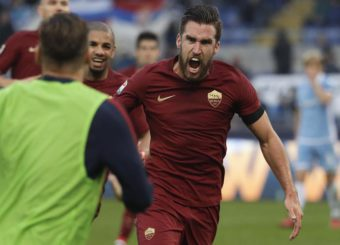Roma's Kevin Strootman celebrates after scoring during a Serie A soccer match between Lazio and Roma, at the Rome Olympic stadium Sunday, Dec. 4, 2016. (ANSA/AP Photo/Gregorio Borgia)